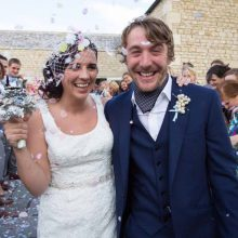 bride-groom-confetti-arch-wedding-guests-throwing-confetti-hyde-barn-wedding-photographer-vintage-wedding-photography-nikki-kirk-photography-cotswold-wedding-photographer.jpg