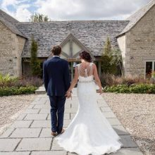 bride-groom-walking-away-from-camera-hyde-barn-wedding-photographer-vintage-wedding-photography-nikki-kirk-photography-cotswold-wedding-photographer-vintage.jpg