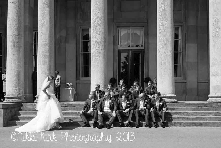 bride-ushers-grooms-walking-Pittville-Pump-Rooms-wedding-photography-Cheltenham-nikki-kirk-photography-wedding-photographer-cheltenham.jpg
