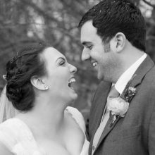 cotswold-wedding-photographer-nikki-kirk-photography-cripps-barn-wedding-photographer-bride-and-groom-laughing.jpg
