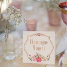 wyck-hill-house-wedding-photographer-nikki-kirk-photography-cotswolds-wedding-photographer-archibald-edwards-table-name-wedding-champagne.jpg