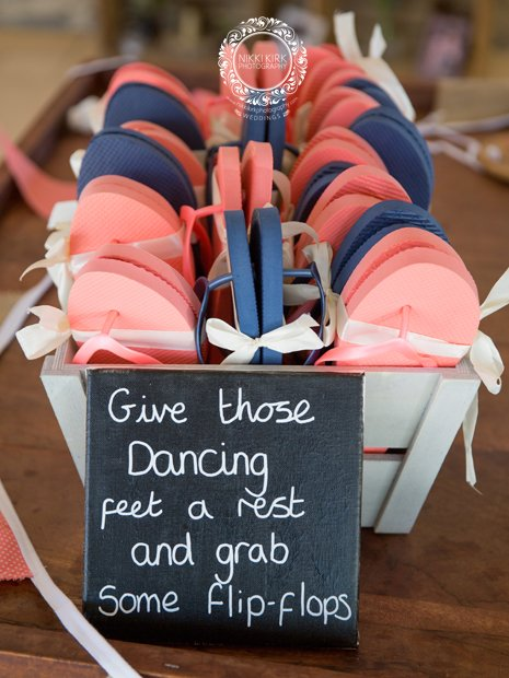 Guest flip flops Kingscote Barn wedding